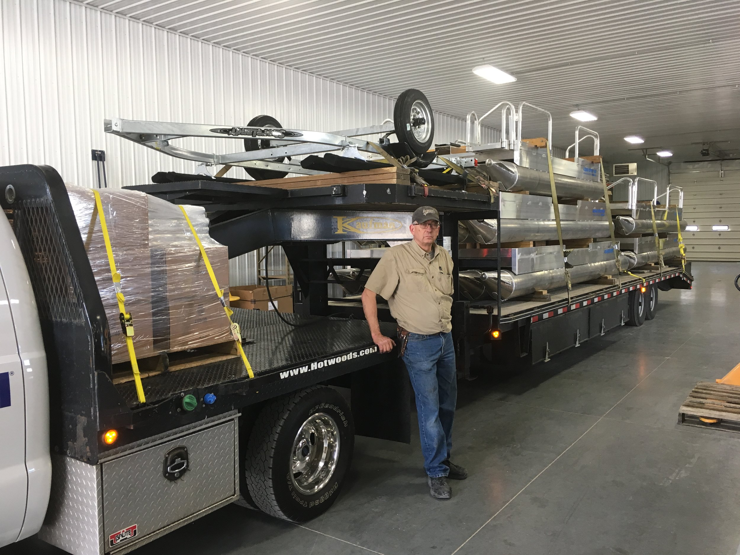 One of our valued drivers Marv getting ready to take off with 5 more boats to customers out east. Marv Has been delivering and working here at Hotwoods for many years.