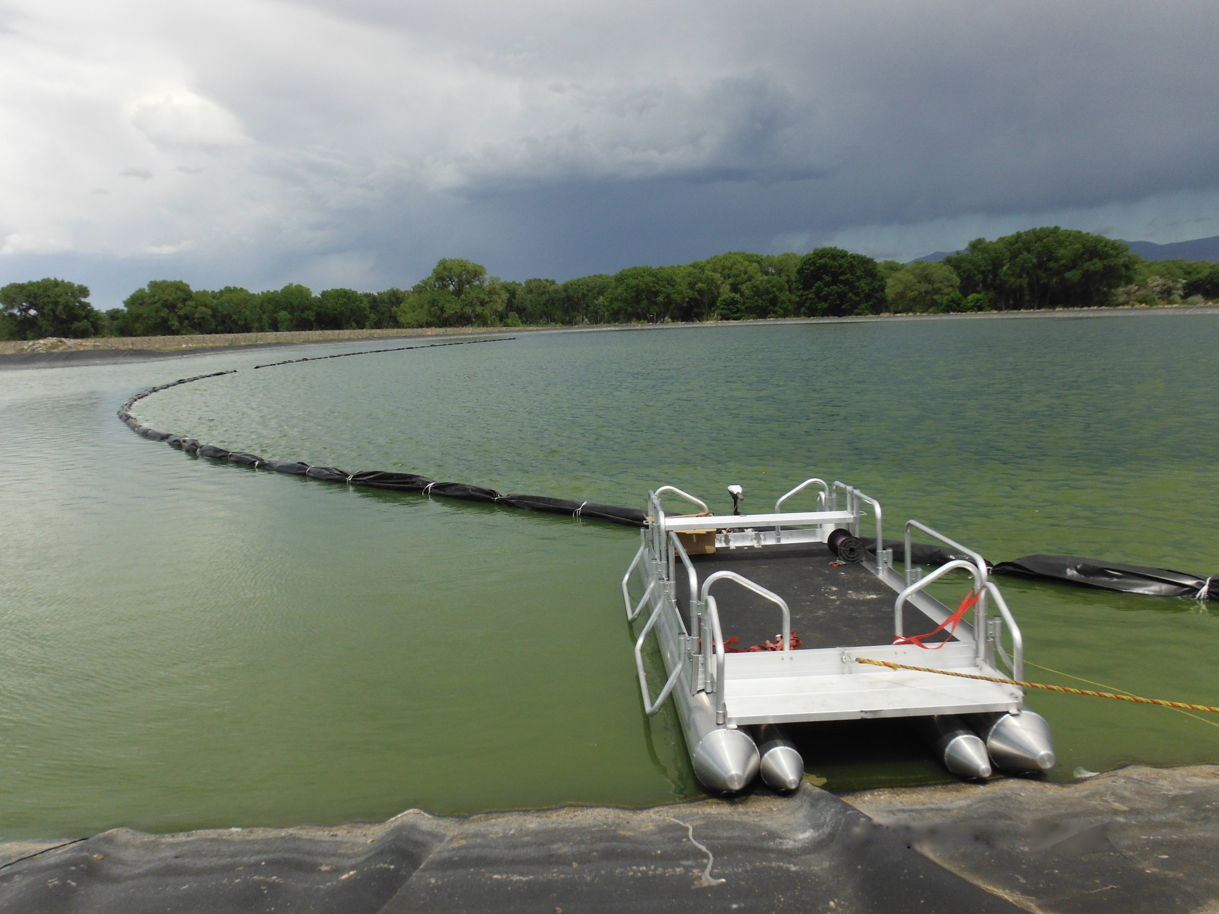 Fish N Sport being used in a water treatment plant in New Zealand. Yes, we ship our pontoon boats world wide to be used for recreation and as work platforms, as shown above.