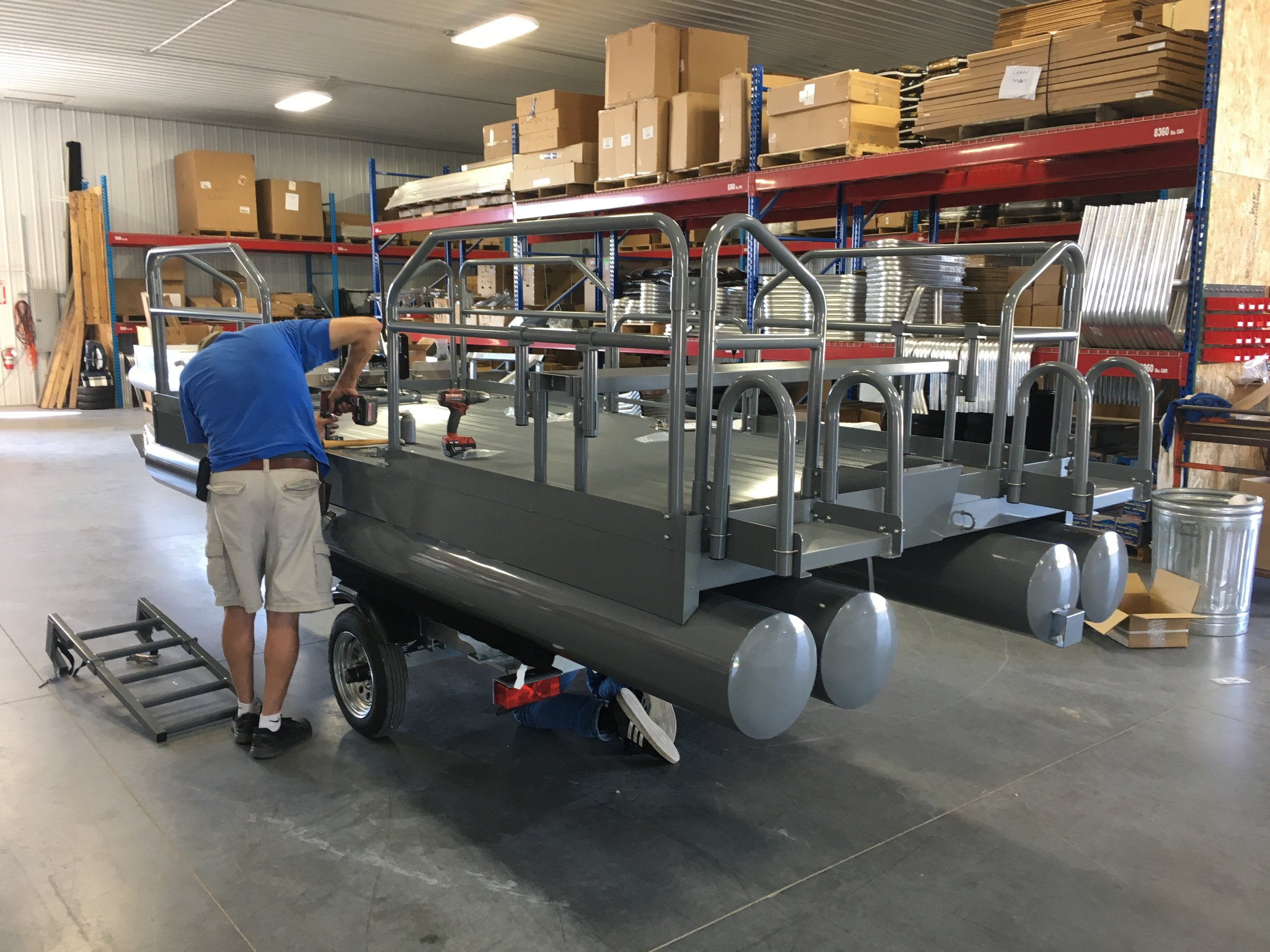 "615 Aluma Sport being assembled for a customer in Yelm Washington with premium powder coat paint, wearing Battle Gray, this craft is almost to nice to use.  Note: 34"" handrails all around with accessory rear battery shelves and side gates along with ladder that is being mounted."