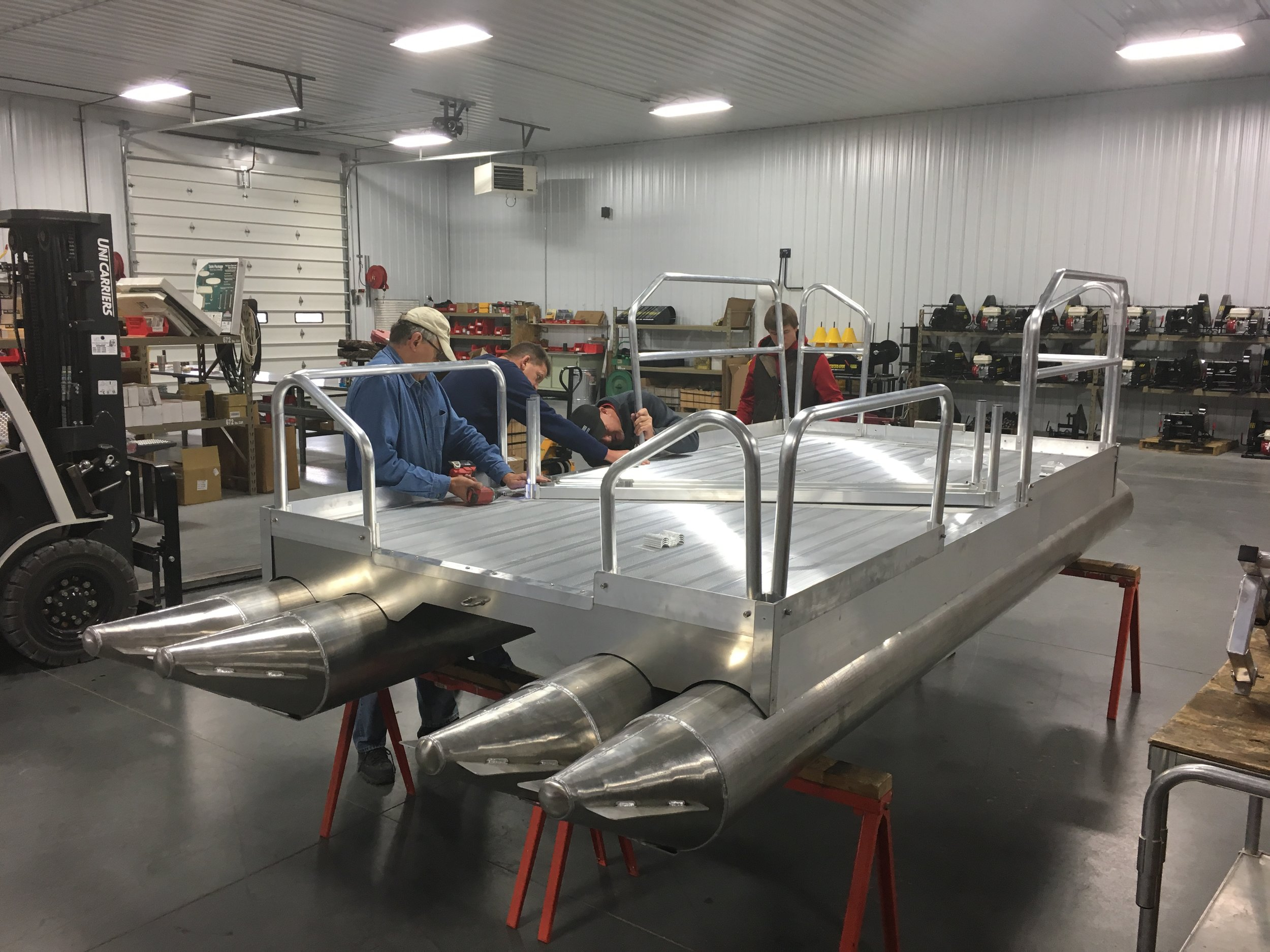 As shown in this photo, every Hotwood's pontoon boat that gets shipped out to a customer goes through a complete inspection for fit and functionality as shown above, before it ever leaves our facility.