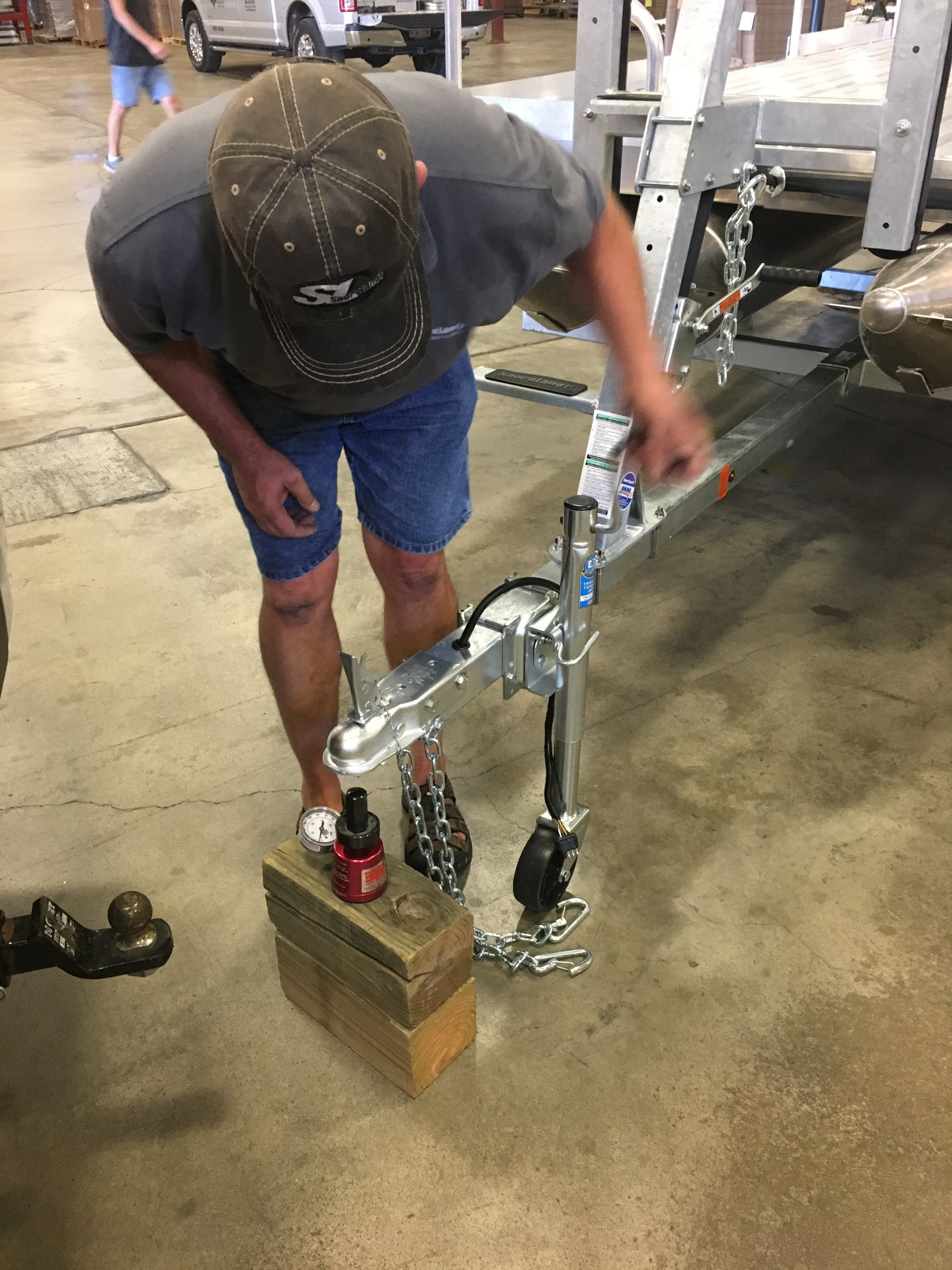 Through tongue weight testing on the 716 Aluma Sport and Shoreland'r trailer, we have it right where we want it at 200 pounds on the ball. This is the perfect weight as it is not to much and it will not bounce on the ball while traveling down the road.