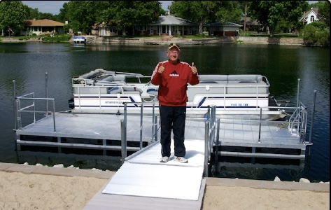 816 dock with 8' walkway and seawall bridge right here in Grand Island Nebraska, along with a very happy customer.