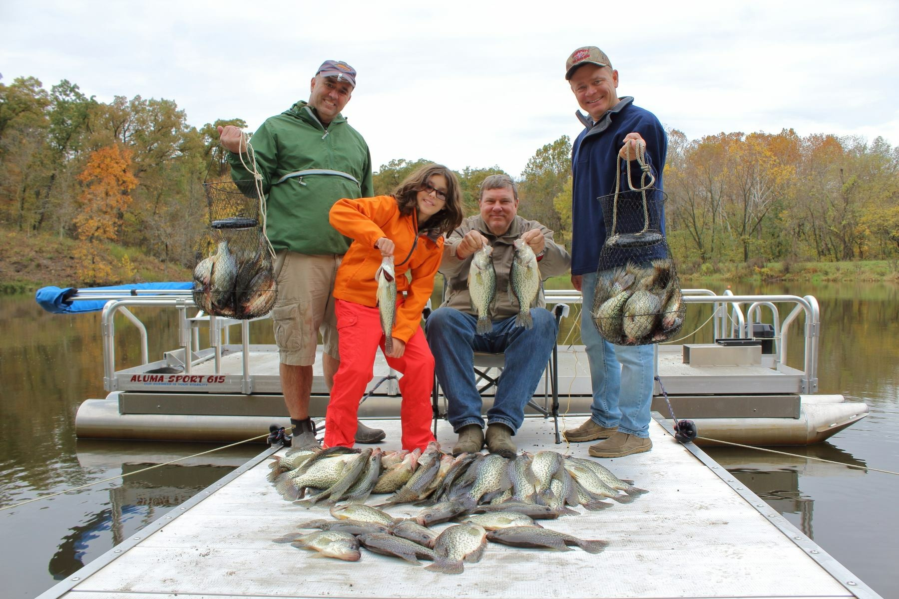 Mahoney Outdoors out of Missouri, uses one of our earlier model 615 Aluma Sport pontoons and also they have a Hotwoods all aluminum dock and walkway. As you see in this photo with these customers they guided, it was a very successful day with 78 crappie brought in. They released many back that were not kept.  Like we are always telling our customers, fishing from a Hotwoods pontoon boat is like standing on the water with the low profile we give you with our design.  This was a great day on the lake. You might want to get ahold of these guys if you want to get some real action with crappie in Missouri.