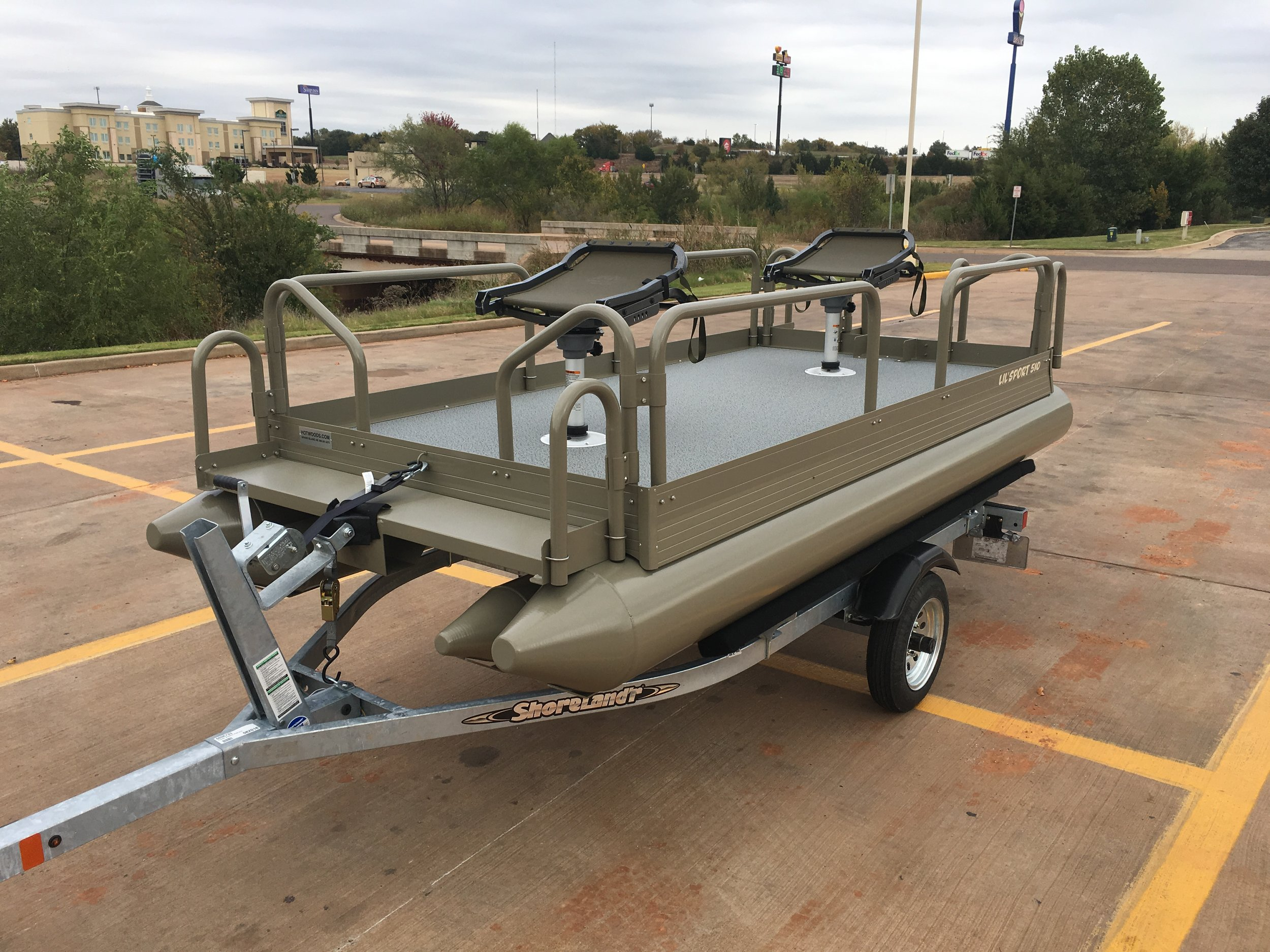 Little Sport shown in Covert Green ( premium powder coated finish ) galvanized Shoreland'r trailer and equipped with 2 millennium seats with removable pedestals.