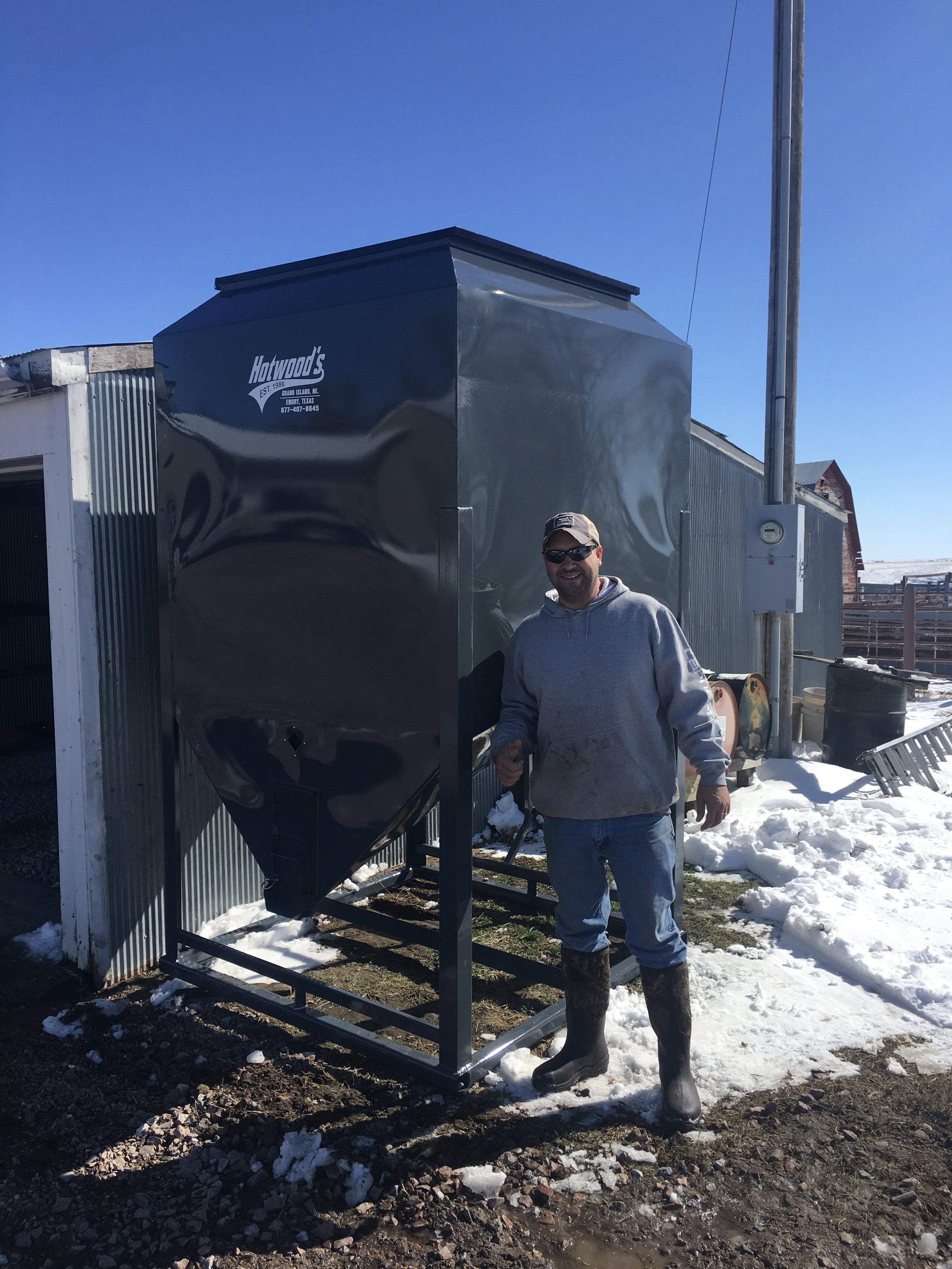 Eric Johnson from Springview Nebraska could not be happier with his purchase and our delivery service after he ordered this 6500 pound stationary bin. Eric has plans to level the ground and block it up when the frost and mud is gone.