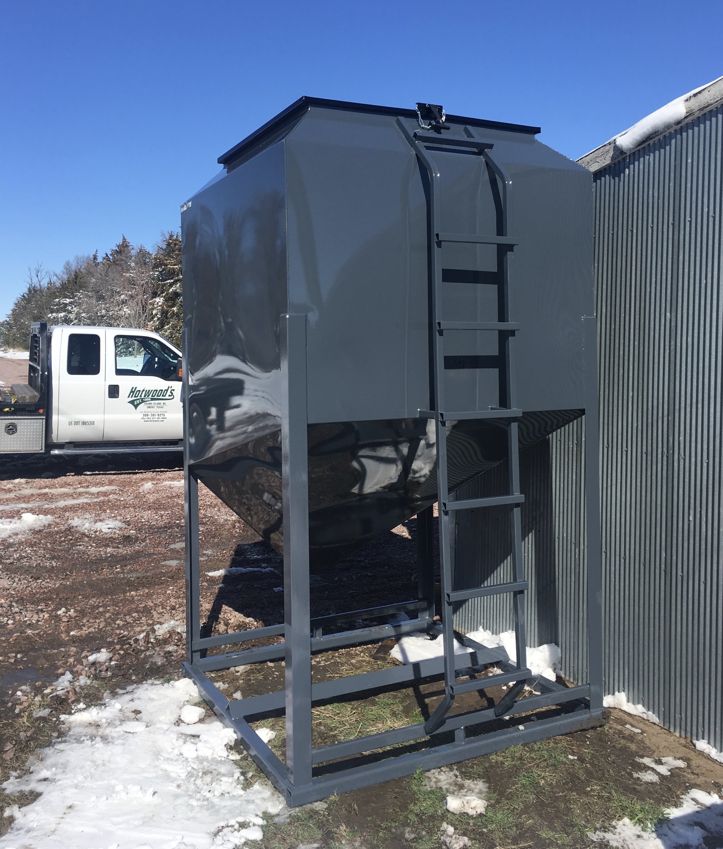 As shown in above photo, the 6,500 Lb. bin comes standard with the ladder welded to the frame work on the bottom and the bin on the top. This assures your safety when climbing up to the top of the bin.