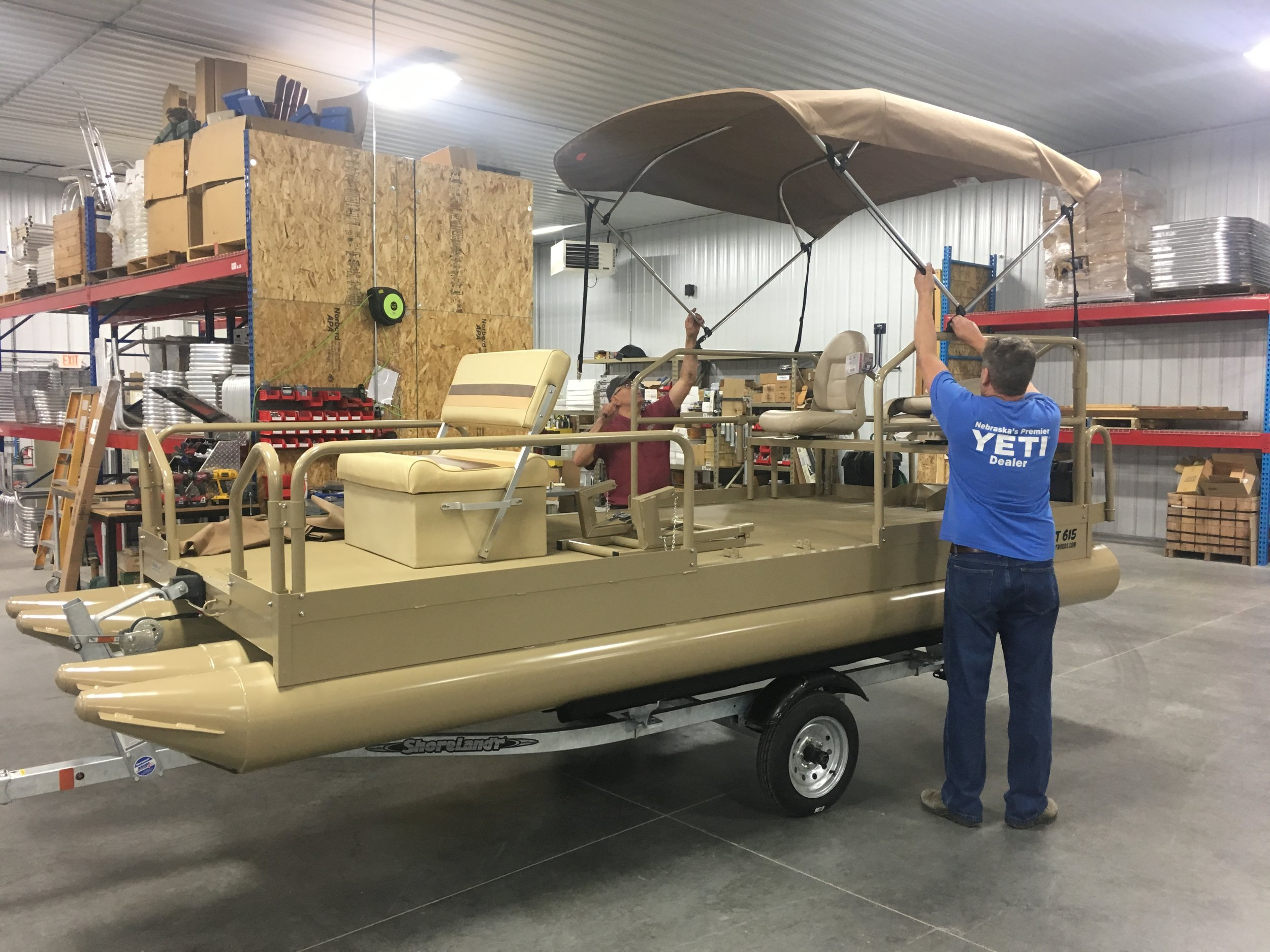 Setting up another tan Aluma Sport 615 for the customer for a pickup in our Grand Island facility. Our premium baked on powder coat paint makes a very nice option when ordering your boat.