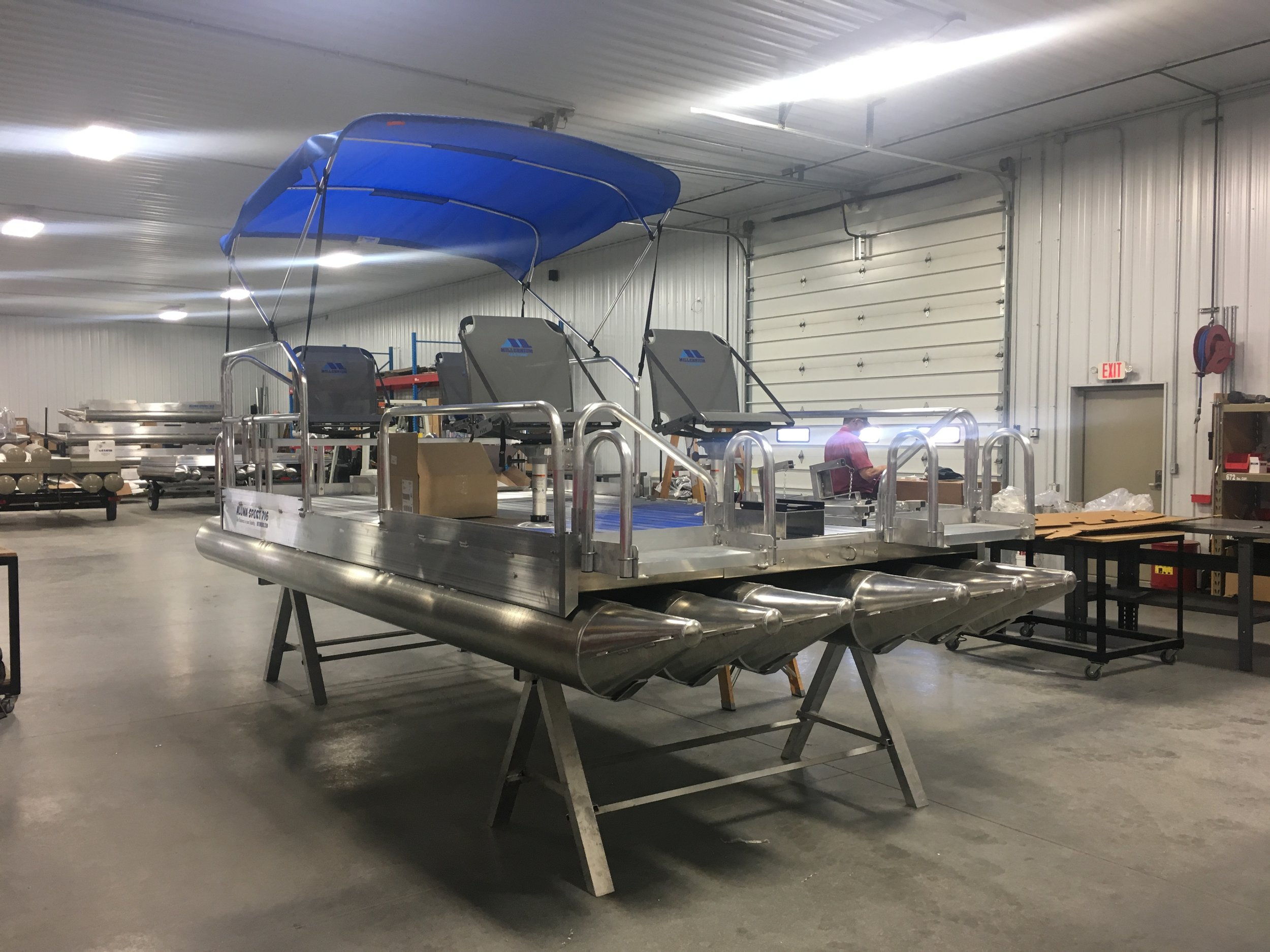 716 Aluma Sport going through final inspection and assembly of accessories in our Grand Island facility prior to delivery to our new customer. This one has been outfitted with the 4 Millennium seats that have become very popular with our customers.