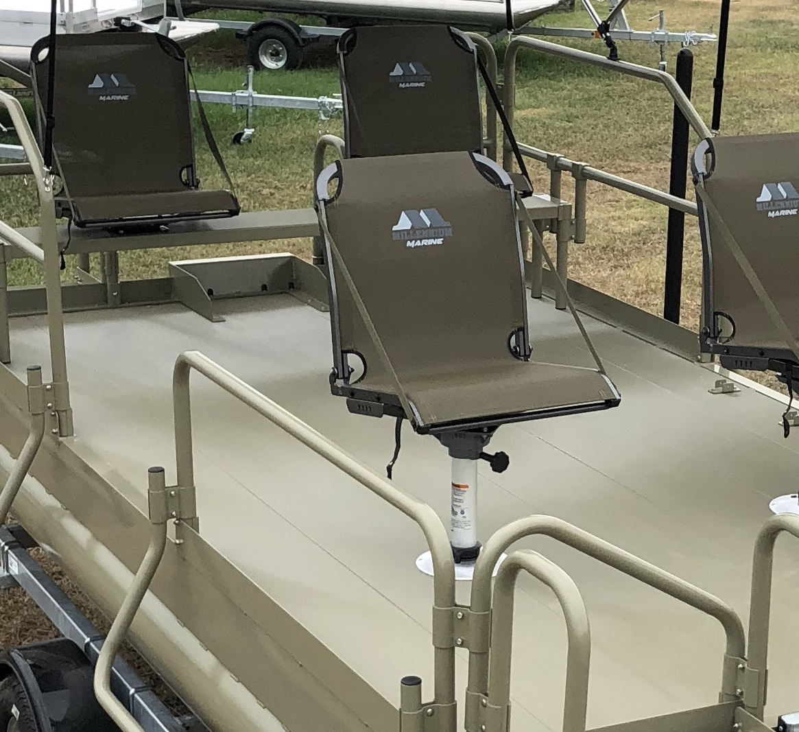 Shown with 4 Millennium seats ( 2) mounted on swivels on the rear bench and ( 2 ) on removable pedestals on the front.
