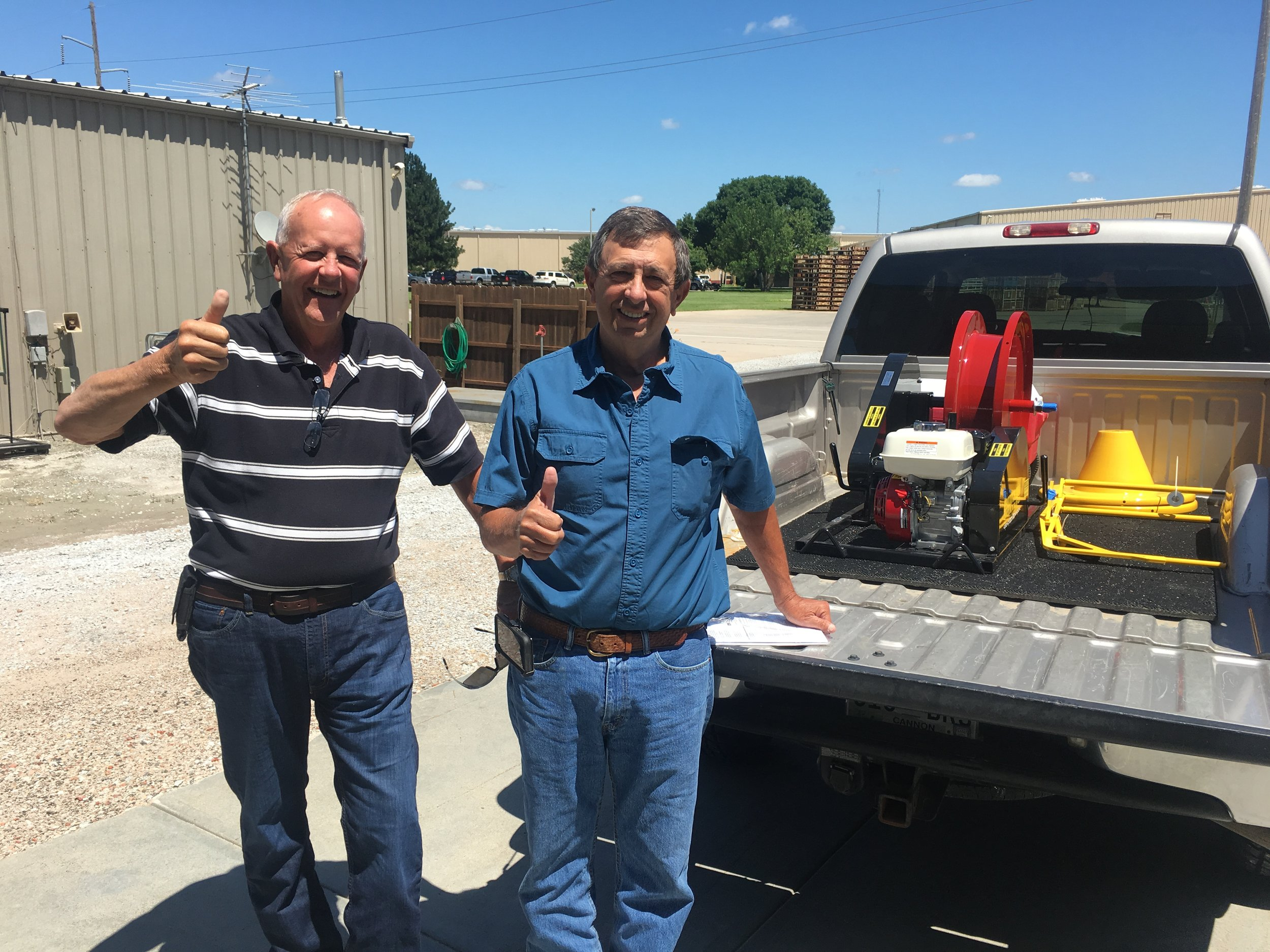Jimmy McElroy ( left ) from Morganfield, Ky. and Fred Adams ( right ) from Readyville, Tn. drove through Grand Island and stopped to picked up a new Honda gas powered winder. After a great visit, they were on their way back home to use their new winder.
