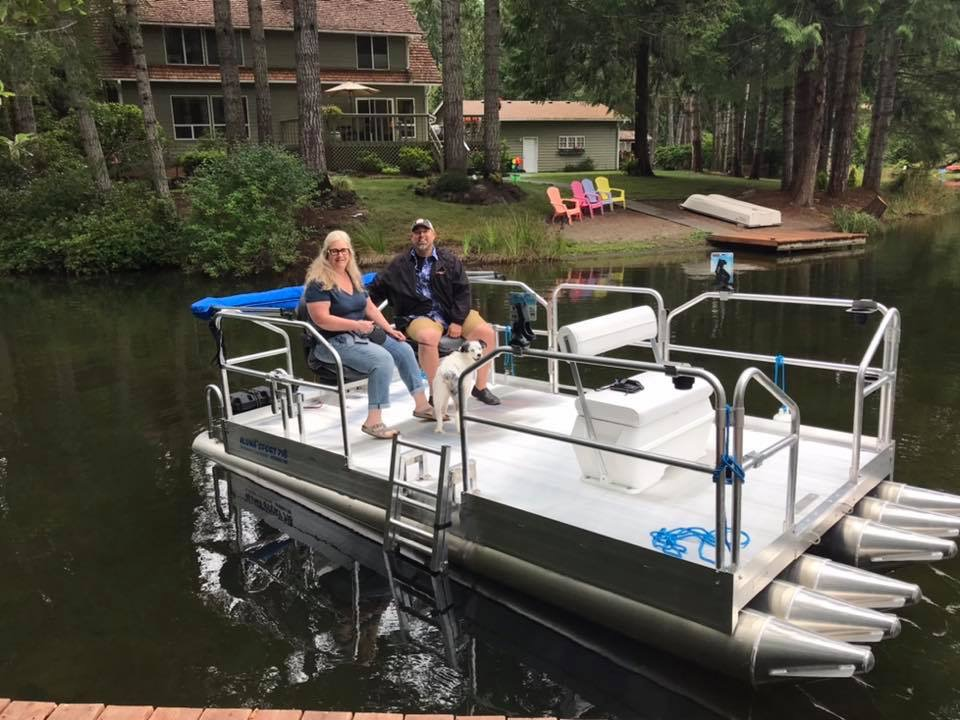 Happy customers in the Seattle Washington area on their new 716 Aluma Sport. ( Shown with optional side ladder, customer added front flip flop bench seat and Dog. )
