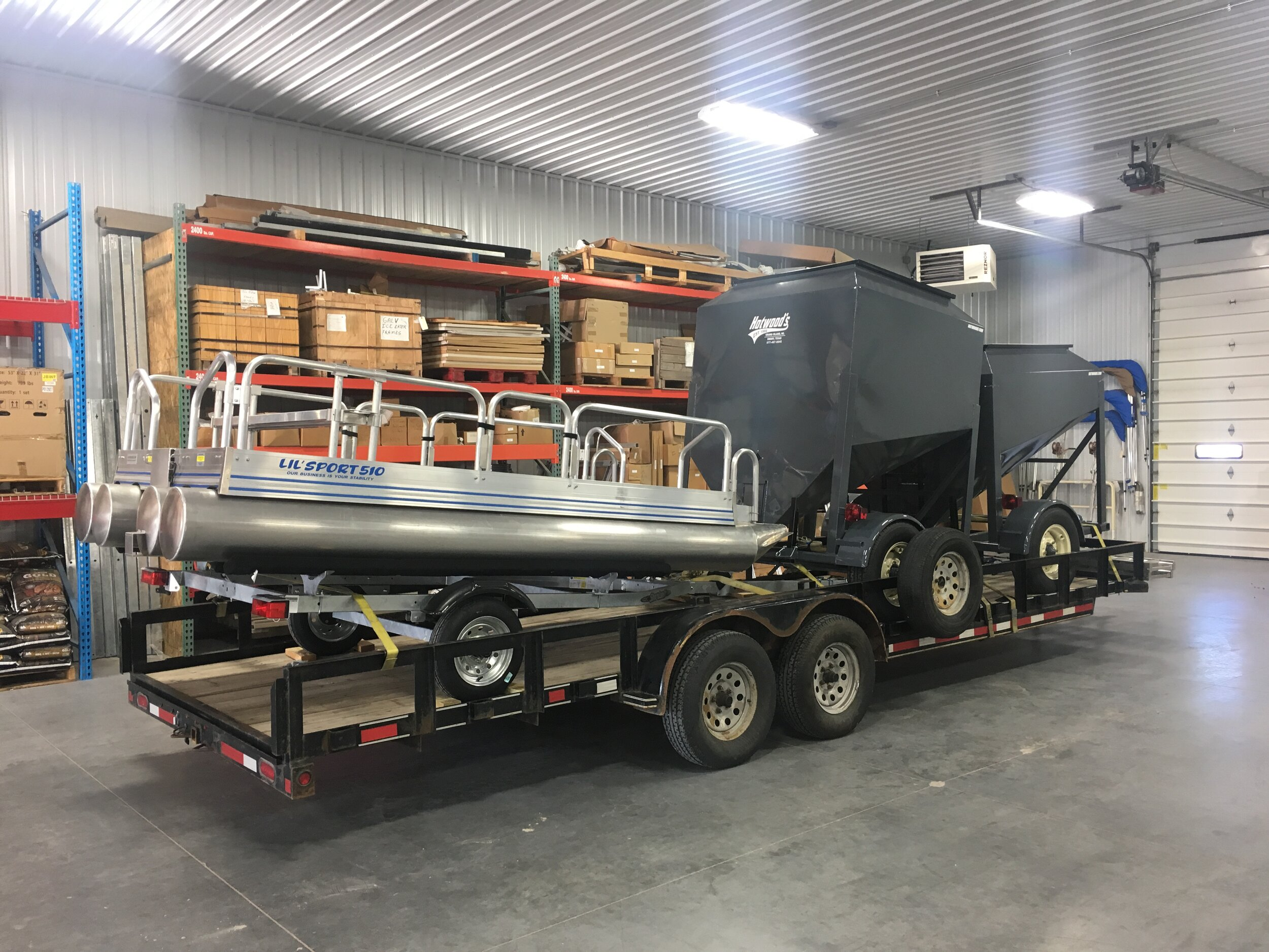 2 Grain Totes and 1 Lil Sport pontoon boat headed for New Jersey. When we say we deliver, that is what we do no matter your location, so do not let distance keep you from calling for a quote.