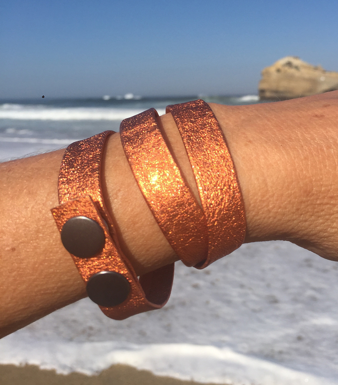 orange bracelet over ocean.jpg