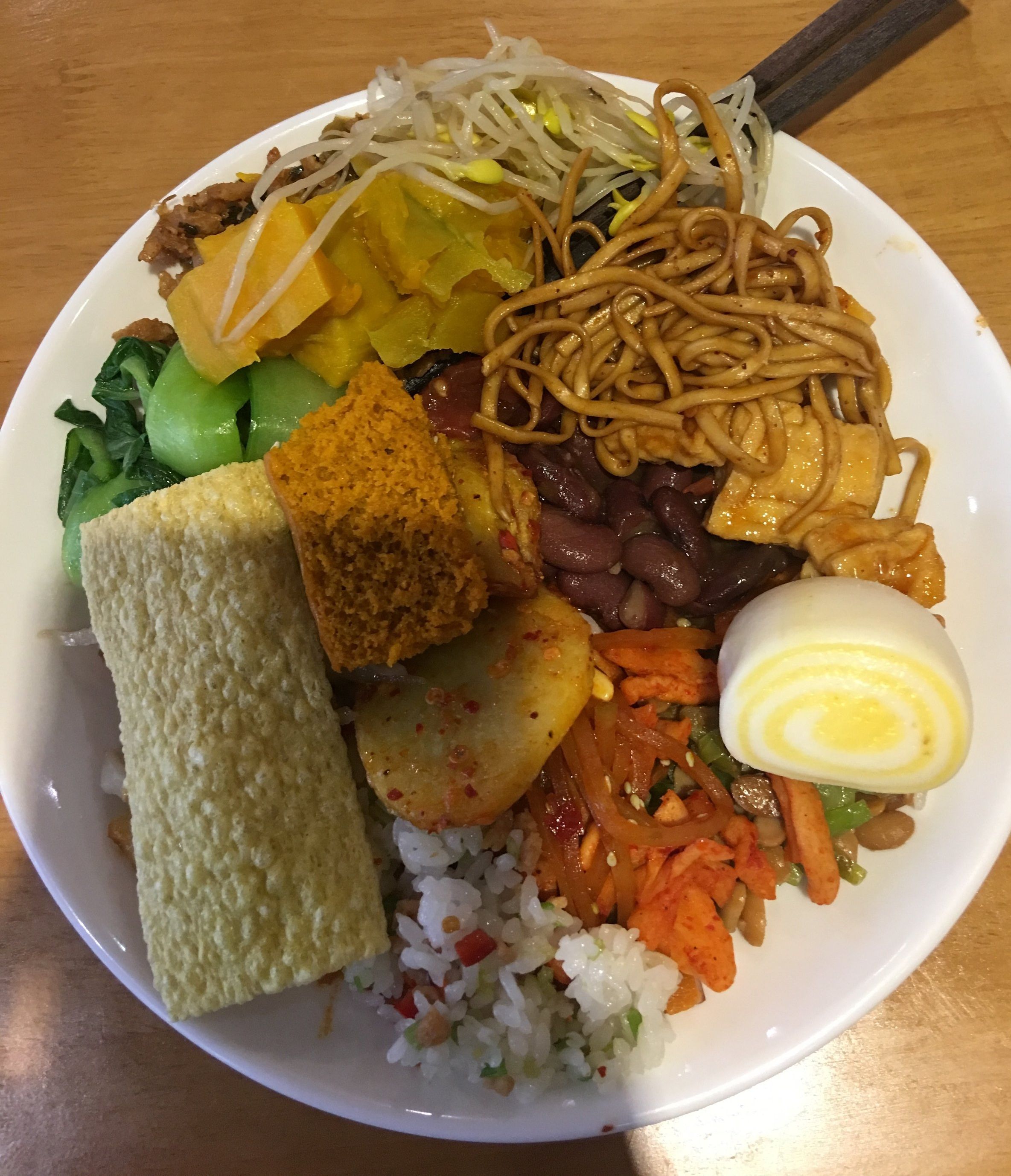 In Buddhism, wasted food is frowned upon, so I had to eat it all.