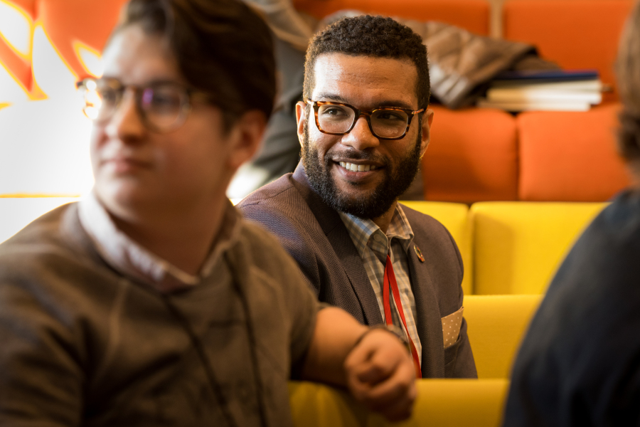 Digital activist Lindsay Amer (left) and Kenneth Chabert (center) listen to their fellow TED Residents introduce themselves. (Photo: Dian Lofton / TED)