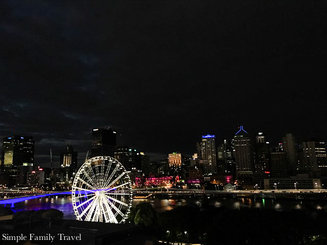 The view of the city from South Bank, including the Brisbane Wheel.