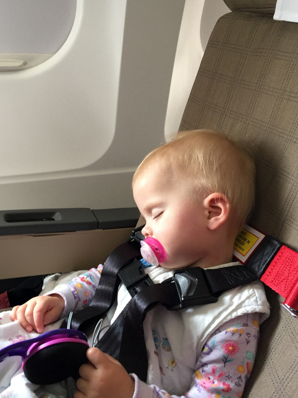 Little Z aged 20 months sleeping soundly in her CARES Harness on our flight bound for Singapore