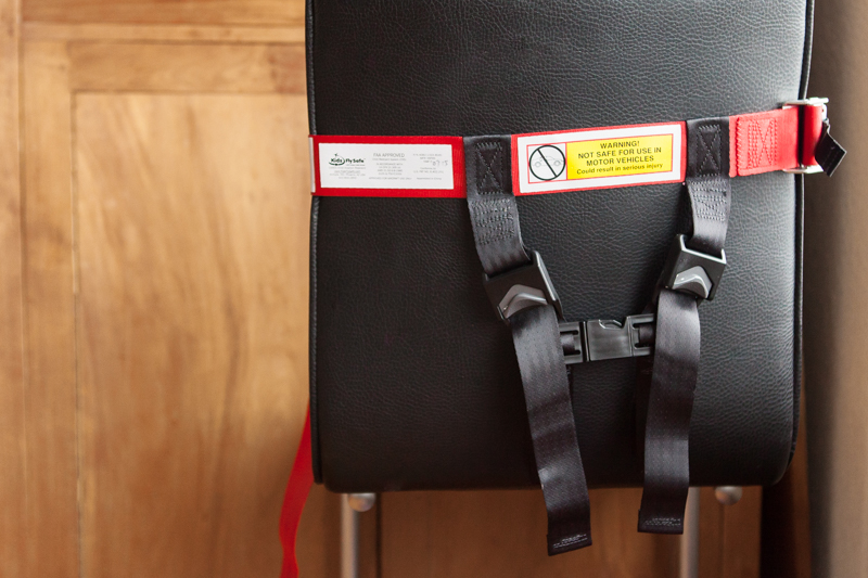 Practise with the harness on your dining room chair before flying to make sure you know how it works!