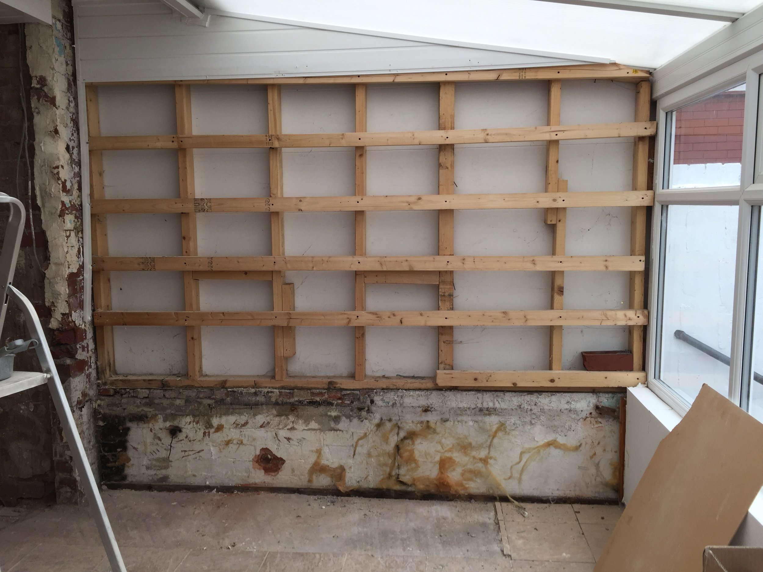 Plastic wall has now been restructured & insulated