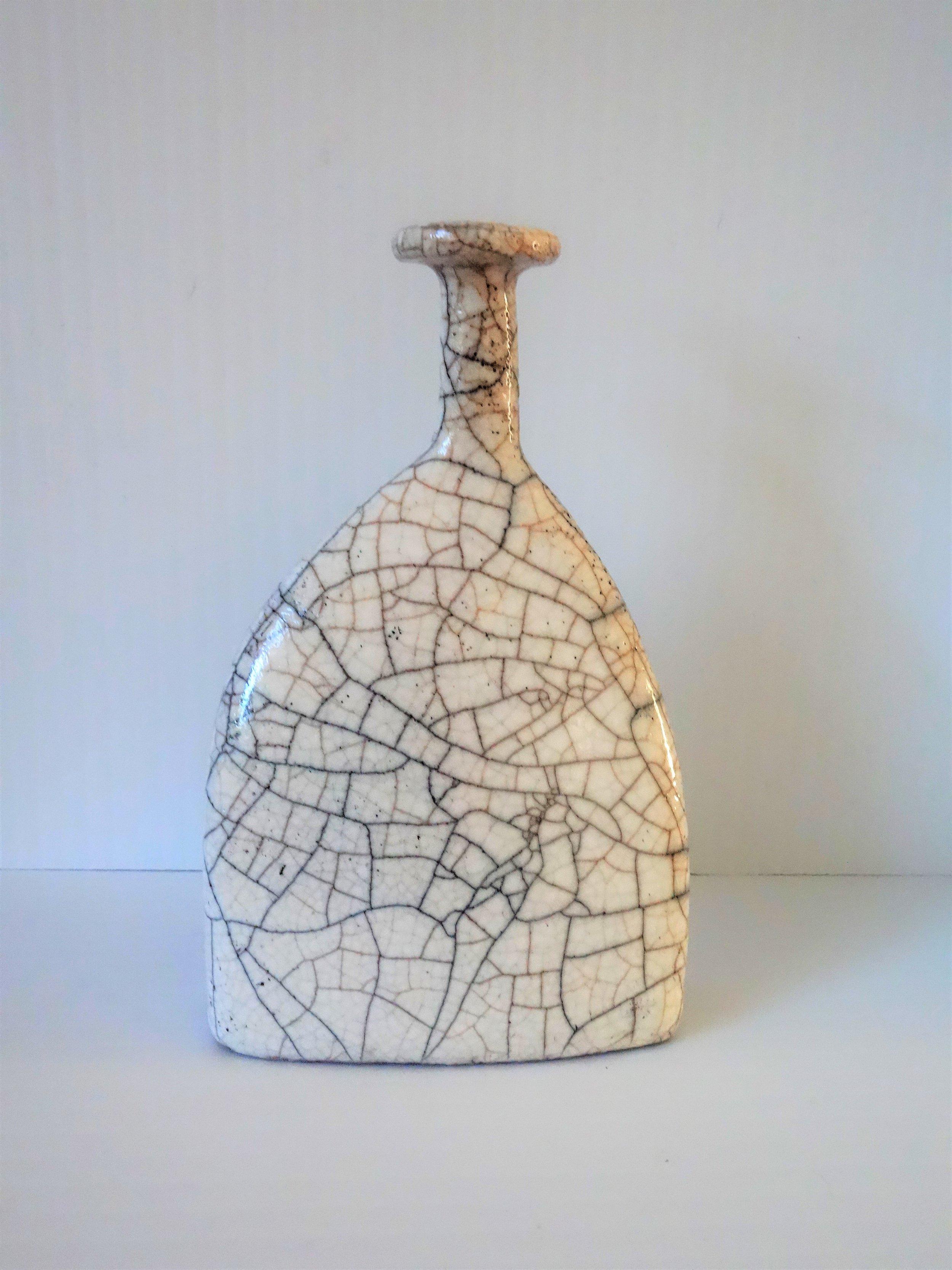 Title White Raku Bottle (round top) Size: 13 cm (h) x 8 cm (w) Medium: Raku Price: £80