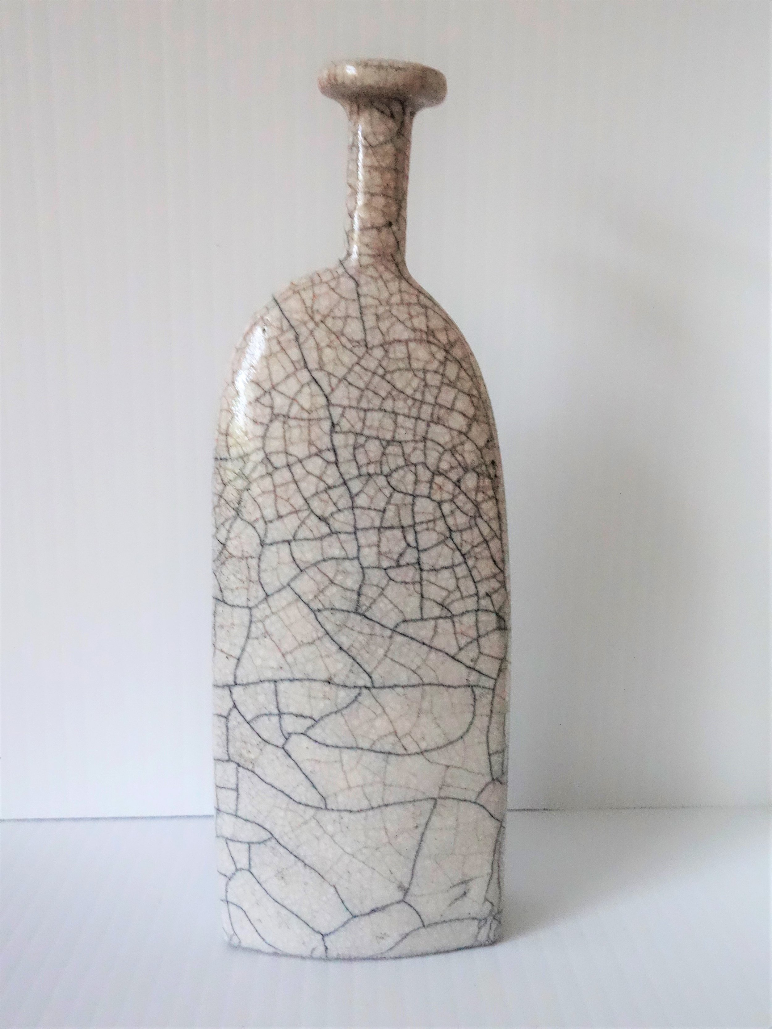 Title: White Raku Bottle (round top) Size: 18 cm (h) x 6 cm (w) Medium: Raku Price: £110