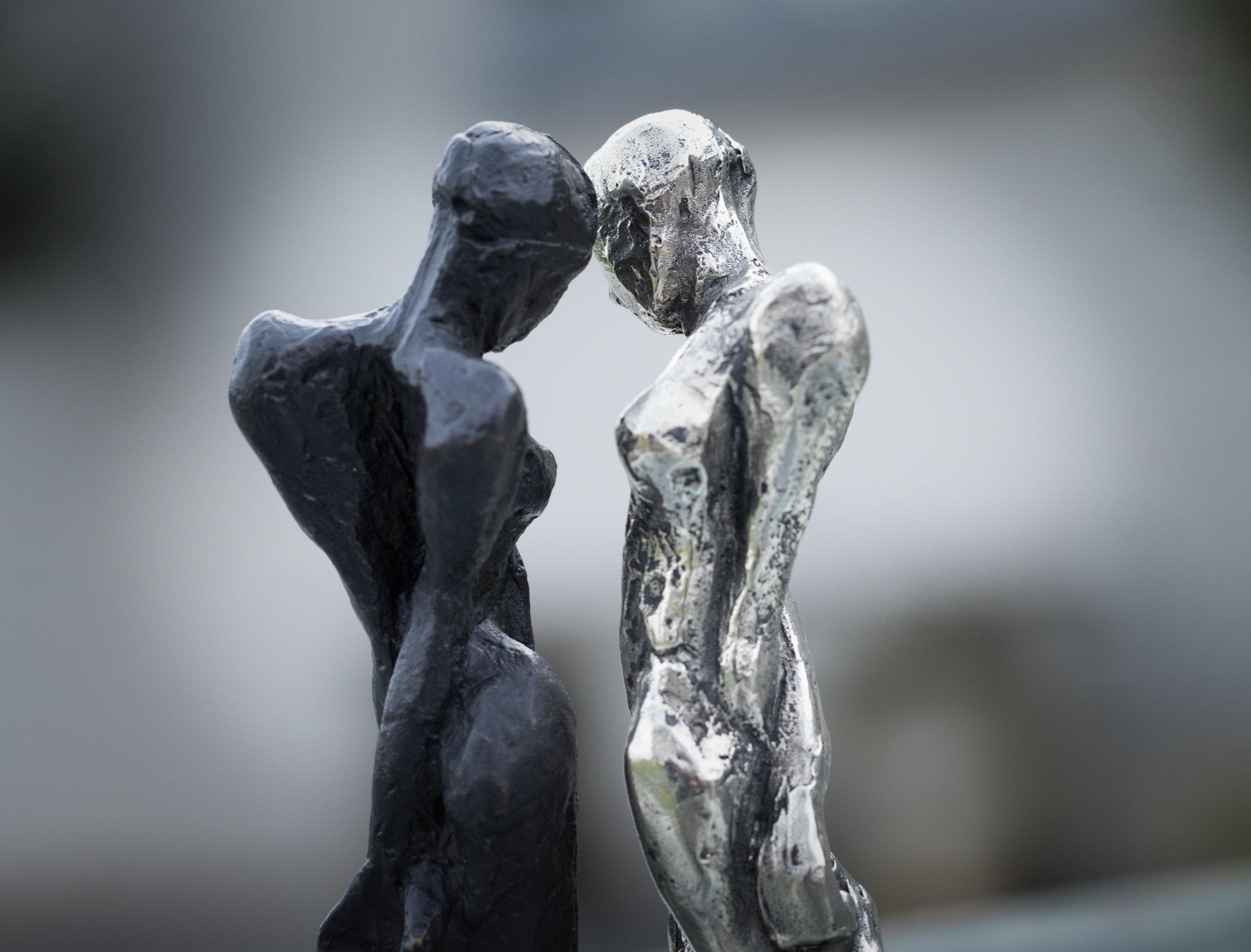 Artist: Kate Viner  Title: Fallen Angels (pair)  Size:  6 x 4 x 3 cm  Medium: Bronze and white bronze  Price: £650