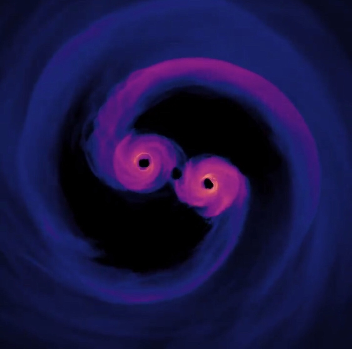 IMAGE: NASA. Computer simulation of two supermassive black holes colliding