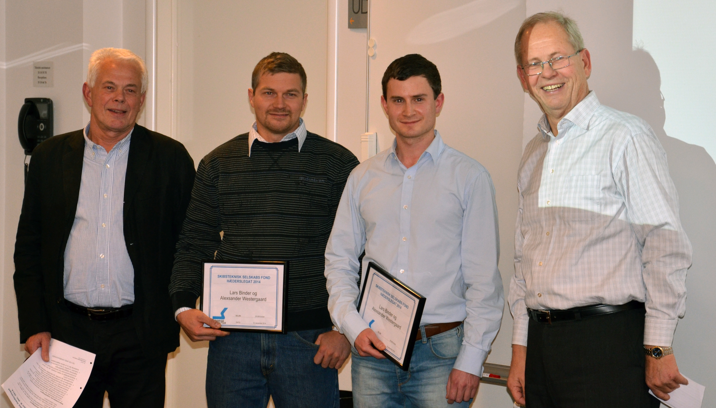 From the left: the recipients Alexsander Westergaard, Lars Binder, Chairman of the board Claus Kruse and Ole Harloff, principal at Københavns Maskinmesterskole