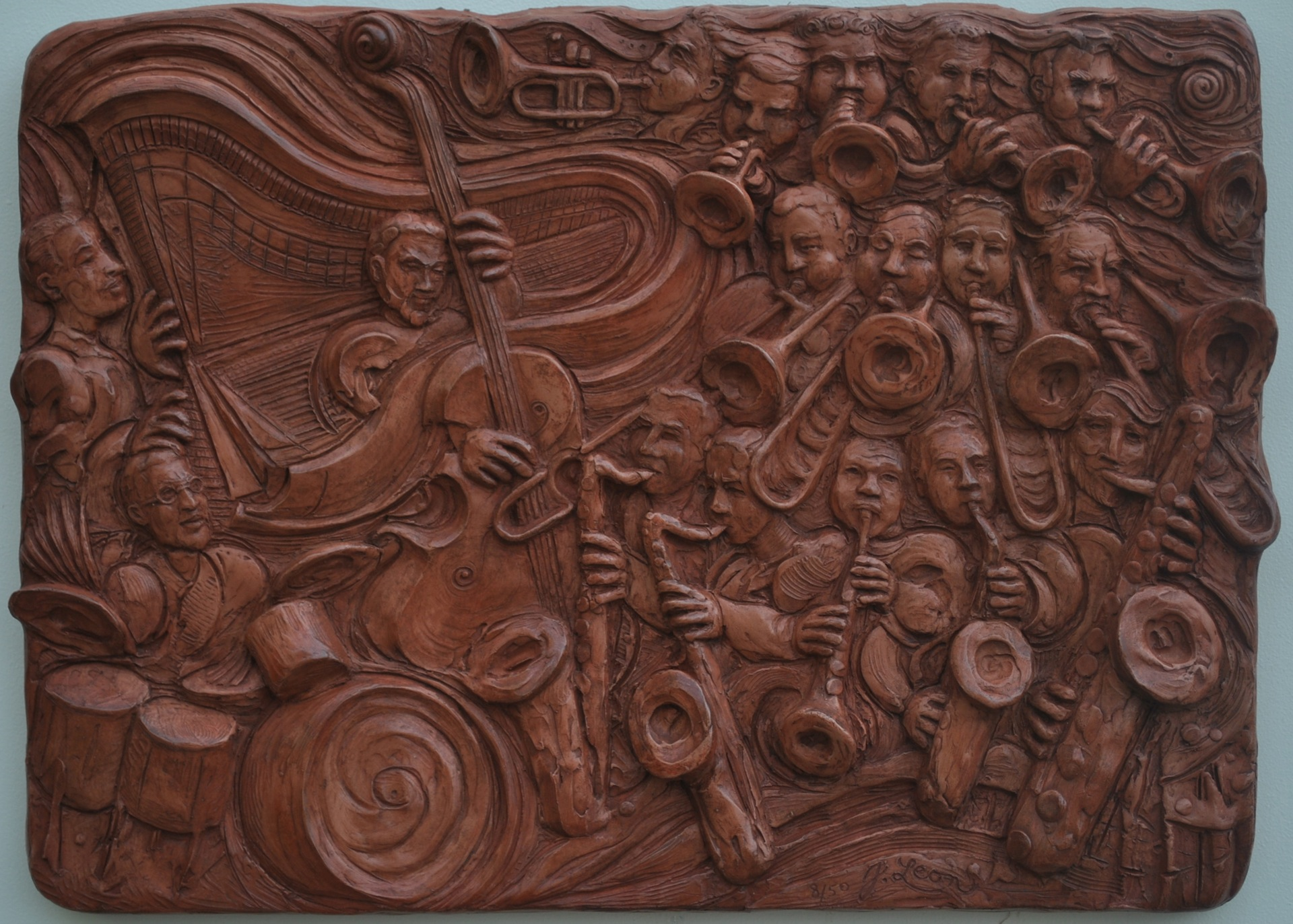 Big Band In a Small Club. Cast stone from clay original. 15 x 20 x 1.5 in. Edition of 50 (over half have been sold). $375 ready for hanging.