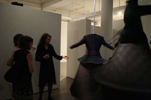 Wherein Fury Takes Flight...Pou (right) with viewers at opening reception