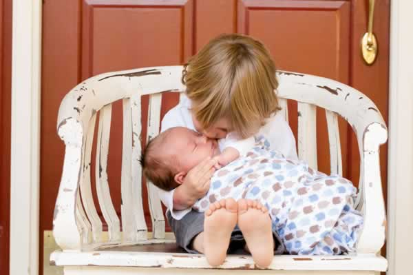boy holding his baby brother