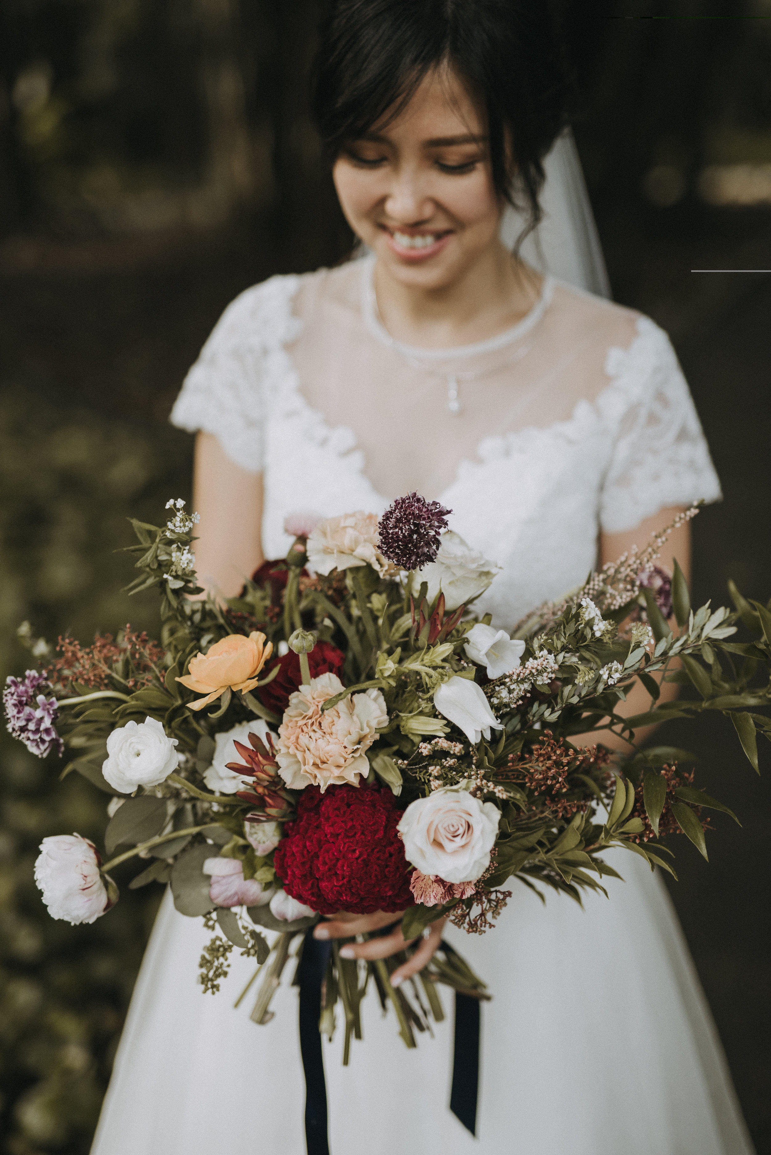 SC is always on the look out to try something new. To describe her everyday style -she loves minimalist design, clean lines silhouette and neutral color tones,nothing over the top. Hence when it comes to her wedding, interestingly, she was willing to explore her flowers in a stronger color palette and chose to go with a more rustic style - of burgundy red, vintage pink, dark purple and overflowing green foliages. A palette that we were pretty excited to try out and a design that we could go crazy with. We love having the freedom to do freestyles.  Our chosen flowers for her - Peonies, Canpanula, Ranunculus, Celosia, Spirea, Scabiosa, Sandy Rose, Dutch Carnations.