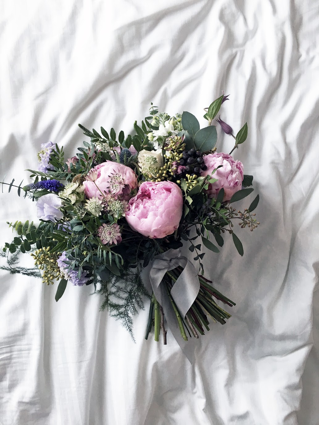What's in the bouquet - Peonies, sweet peas, spray roses, roses, astrantia, matthiola, veronica, clementis and a whole lot of other filler flowers and foliages that we love.