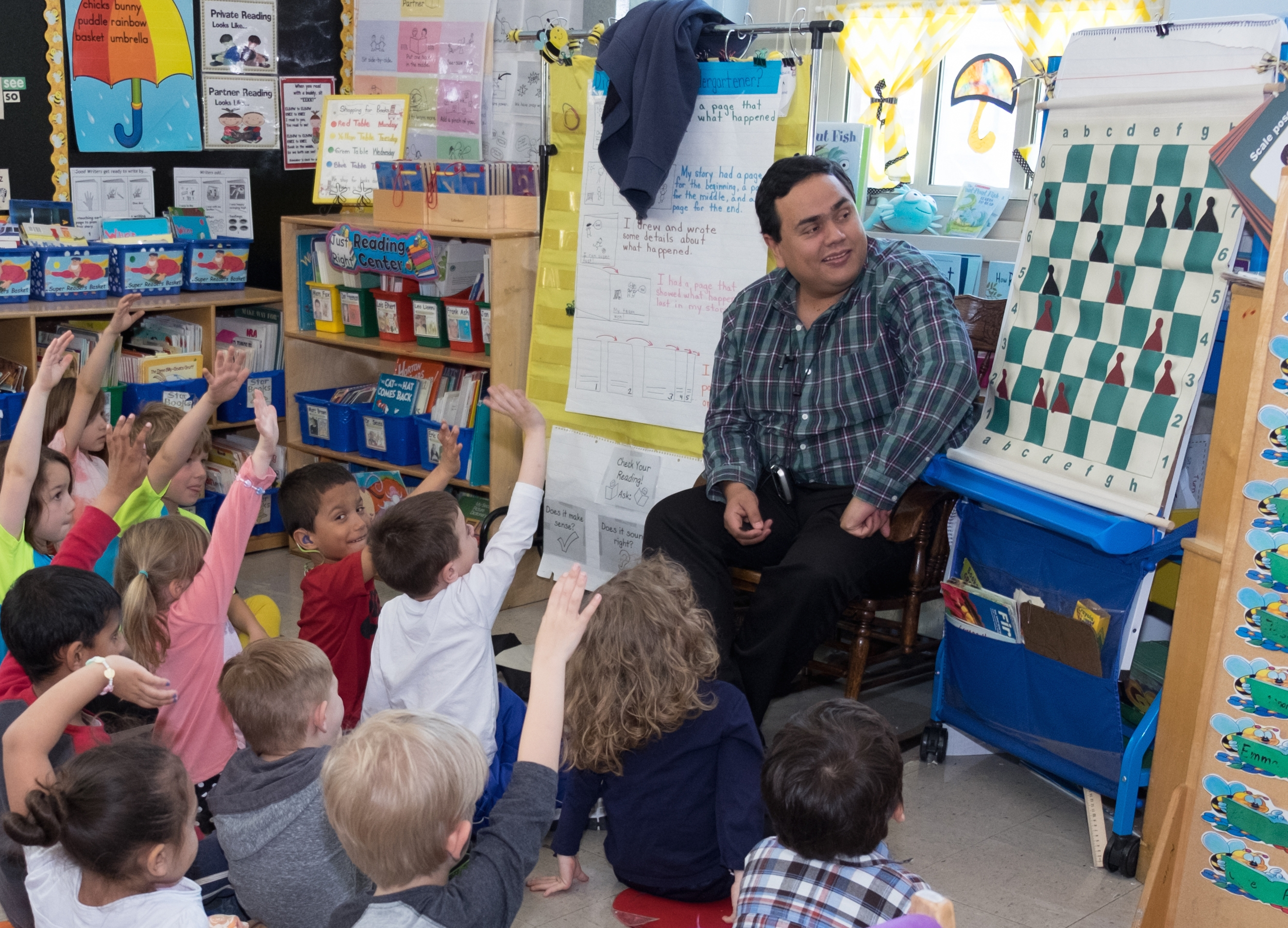 Mr. Jairo plays a game with a kindergarten class to teach how pawn moves.