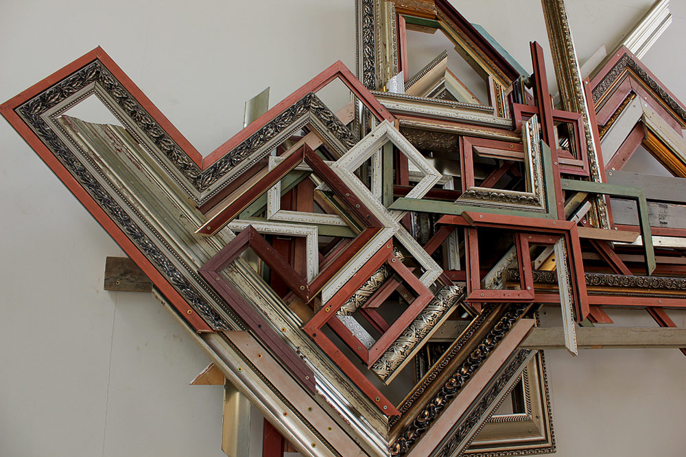 Lao Wai (Undocumented Relationship)  found picture frame moulding, nails, screws, 2011, 7' x 9'