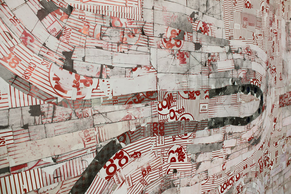 """Neikro  2010  popcorn boxes, paper hot dog trays, water and soda bottle tops, india ink. 72"""" x 60"""""""