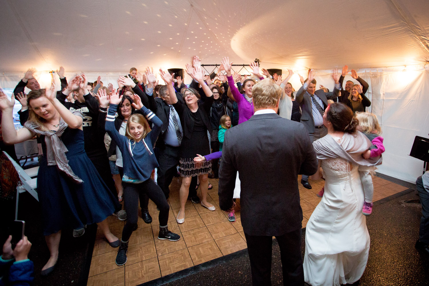 Abby and John's wedding party got most of their guests to kick off the dance portion of the evening with a surprise flash mob to Justin Timberlake's can't stop the feelin'