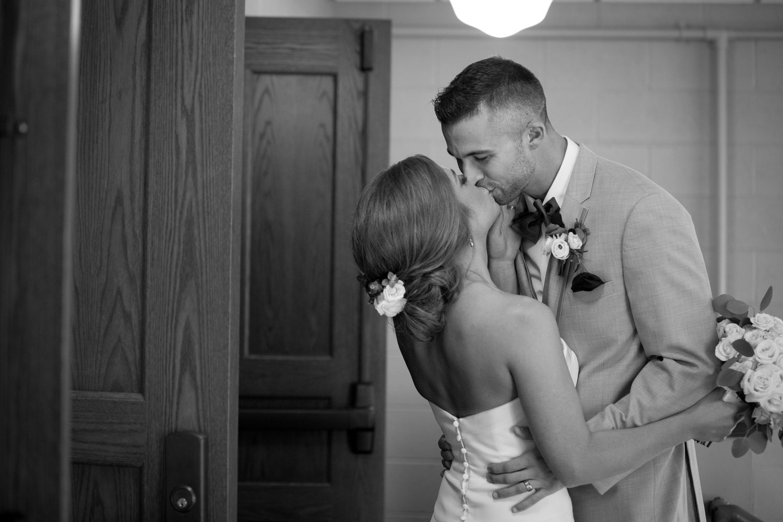 16-bride-groom-post-ceremony-kiss-mahonen-photography.jpg