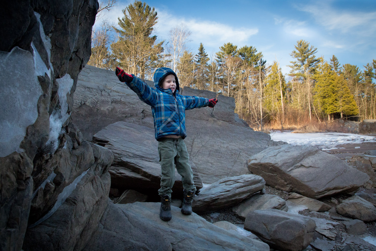 He is happiest when climbing around on giant rocks!