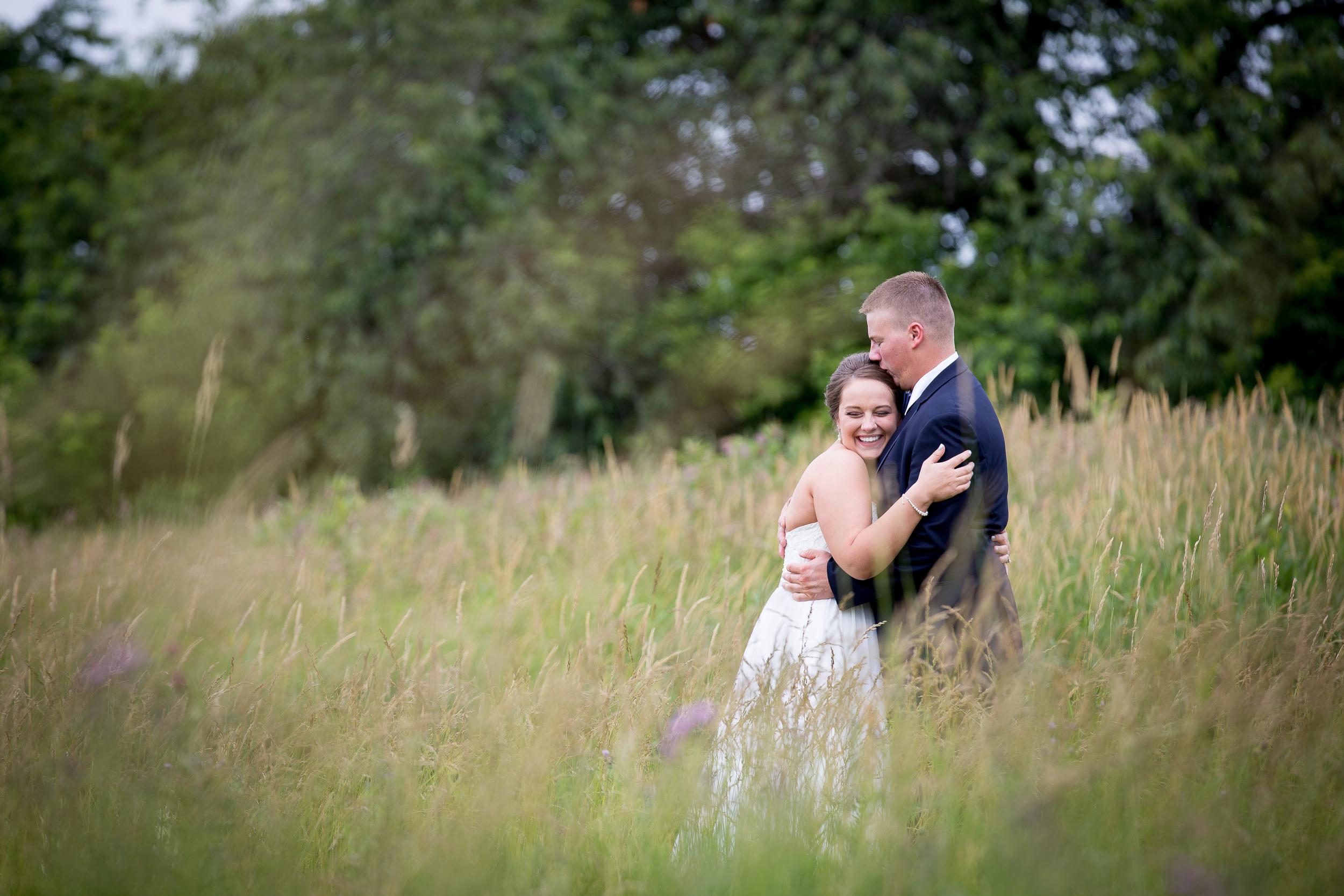 bride groom wildflower field minnesota wedding photographer backyard