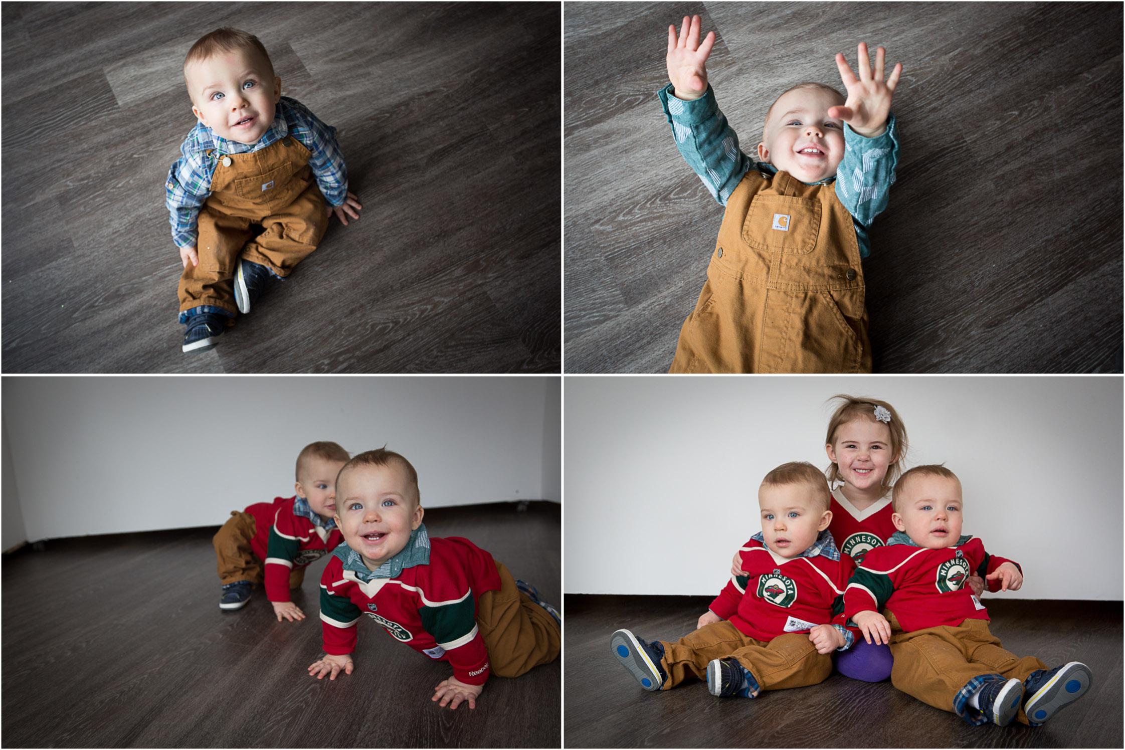 06-baby-wild-hockey-jerseys-twin-boys-one-year-old-big-sister-family-of-three-photo-session-studio-gray-couch-carhardt-overalls-block-studios-minnesota-mahonen-photography.jpg