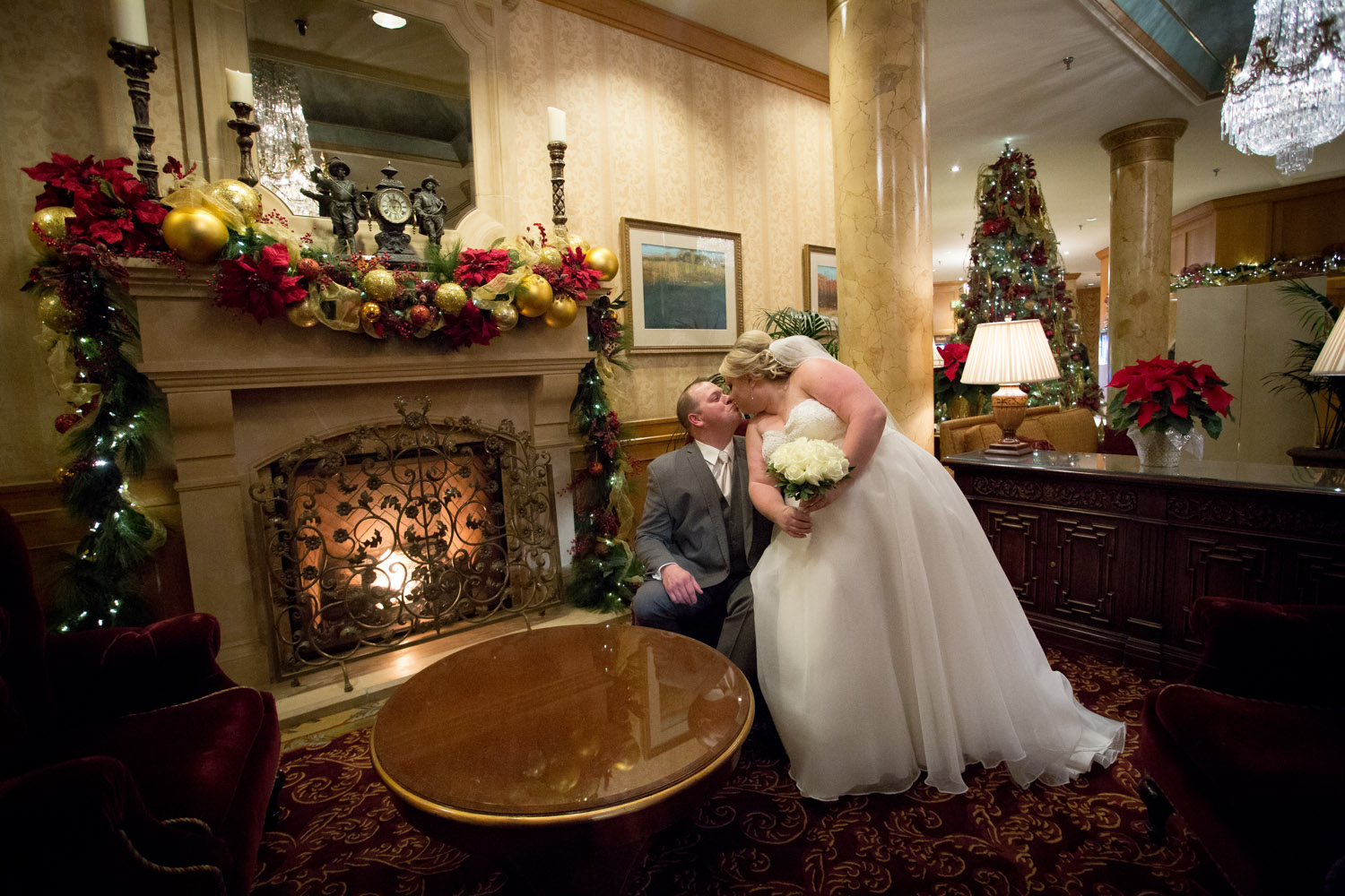06-the-st-paul-hotel-wedding-day-new-years-eve-minnesota-winter-bride-and-groom-portrait-cozy-fireplace-mahonen-photography.jpg