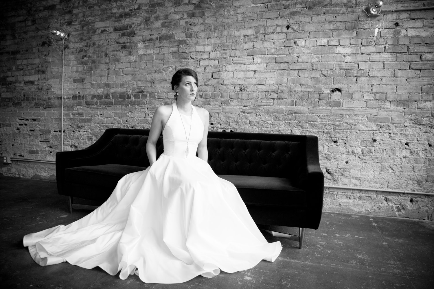 08-bride-halter-bridal-gown-black-and-white-brick-wall-loring-social-minneapolis-mahonen-photography.jpg