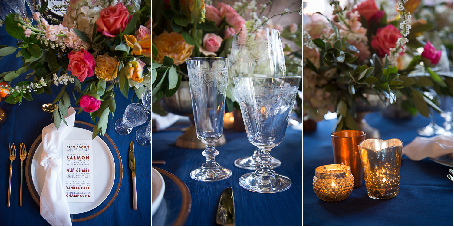 18-wedding-reception-head-table-details-blue-linen-glass-etched-goblets-knotted-napkin-gold-rimmed-charger-plates-mahonen-photography.jpg