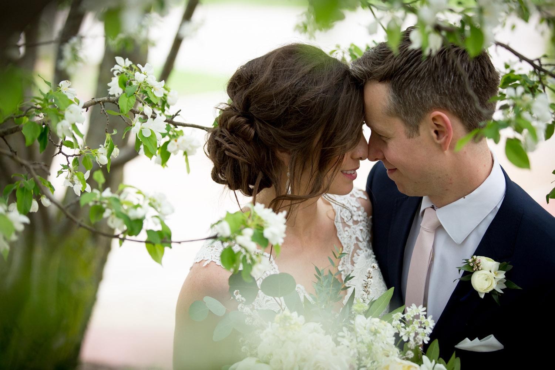 11-spring-bride-groom-portrait-flowering-crab-apple-tree-navy-blue-suite-pink-tie-lace-wedding-gown-mahonen-photography.jpg