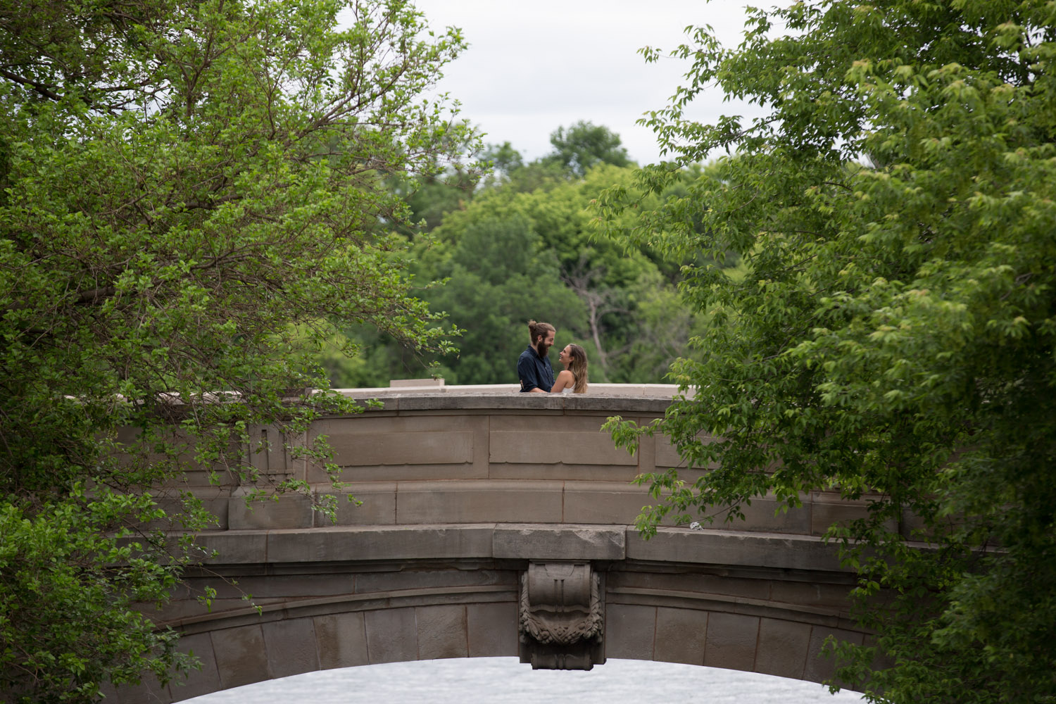 07-lake-of-the-isles-bridge-uptown-minneapolis-engagment-photographer-mahonen-photography.jpg