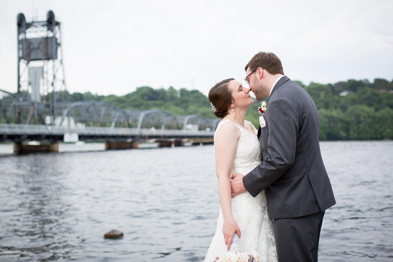 11-historic-downtown-stillwater-minnesota-wedding-photographer-bride-groom-fun-portraits-lift-bridge-mississippi-river-lacy-bridal-gown-mahonen-photography.jpg