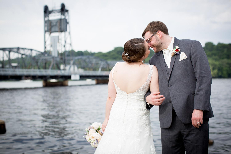 12-historic-downtown-stillwater-minnesota-wedding-photographer-bride-groom-fun-portraits-lift-bridge-mississippi-river-lacy-bridal-gown-mahonen-photography.jpg