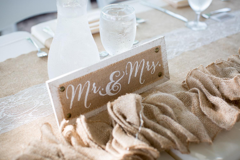 15-wedding-reception-details-head-table-mr-and-mrs-burlap-lace-stone-ridge-golf-club-still-water-minnesota-wedding-photographer-mahonen-photography.jpg