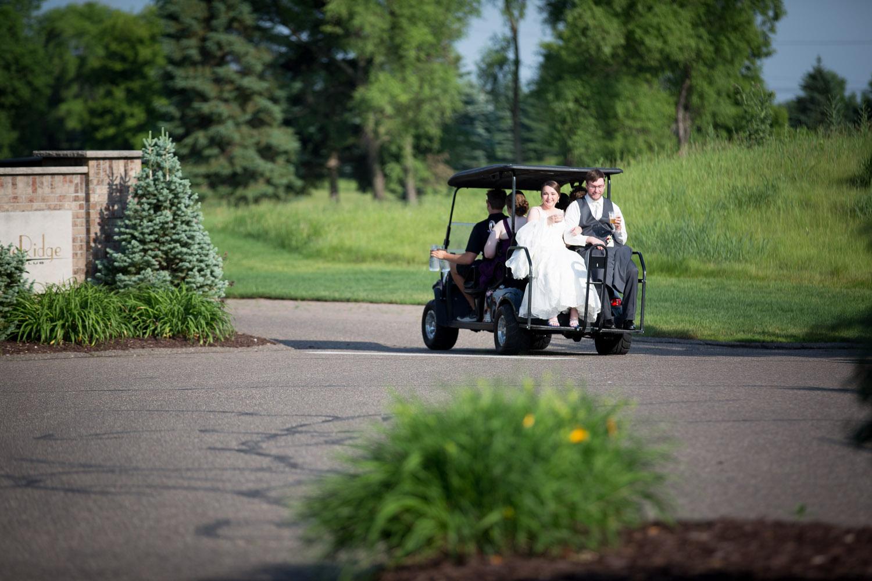 17-stone-ridge-golf-club-stillwater-minnesota-wedding-reception-photographer-bride-groom-golfcart-ride-mahonen-photography.jpg